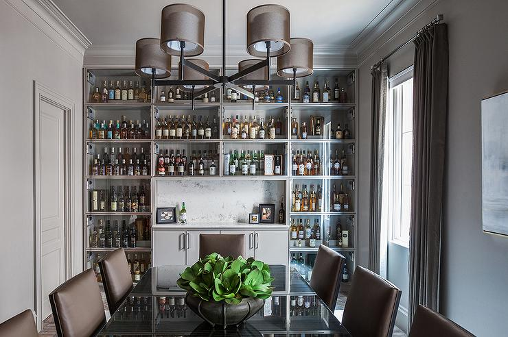 Wonderful Gray Dining Room With Full Wall Of Built In Glass Front Bar Cabinets