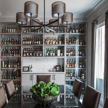 Gray Dining Room With Full Wall Of Built In Glass Front Bar Cabinets