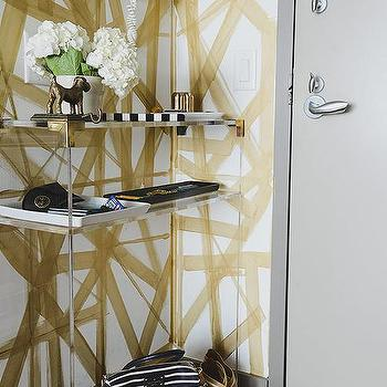 White And Gold Painted Walls With Brass And Lucite Console Table