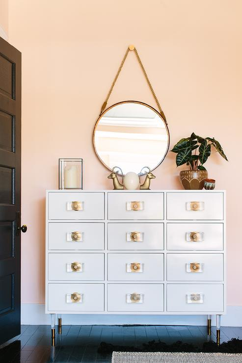 Pink Foyer With White And Gold Apothecary Cabinet With Lucite Feet