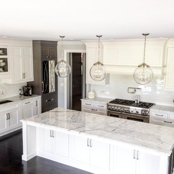 White and gray kitchen cabinets with antiqued mirrored Best pendant lights for white kitchen