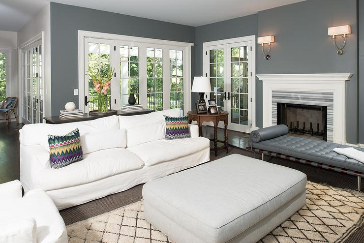 White And Charcoal Gray Living Room With Symmetric Twist Sconces Gray Living Room White Fireplace