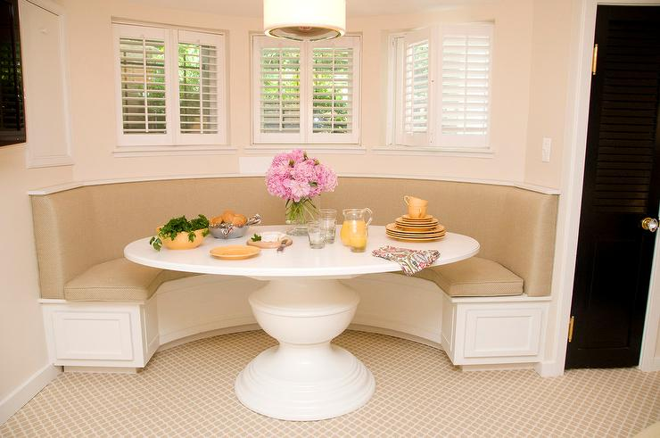 curved dining banquette with a white oval dining table transitional dining room. Black Bedroom Furniture Sets. Home Design Ideas