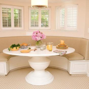 Delightful Curved Dining Banquette With A White Oval Dining Table