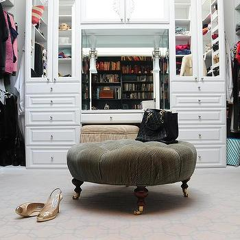 Walk In Closet With Round Tufted Ottoman On Caster Legs