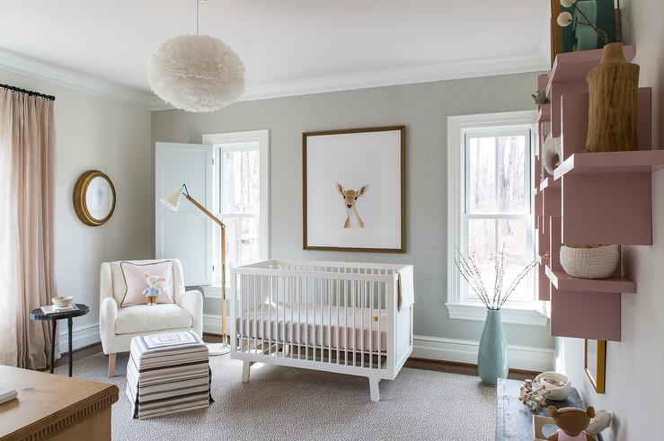 pink and gray nursery features an accent wall clad in gray textured wallpaper lined with a baby deer little darling print over a white oeuf sparrow crib - Oeuf Sparrow Crib