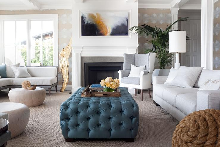 Chic Living Room Features A Heather Gray Sofa Facing A Deep Blue Tufted  Ottoman As Coffee Table. Part 47