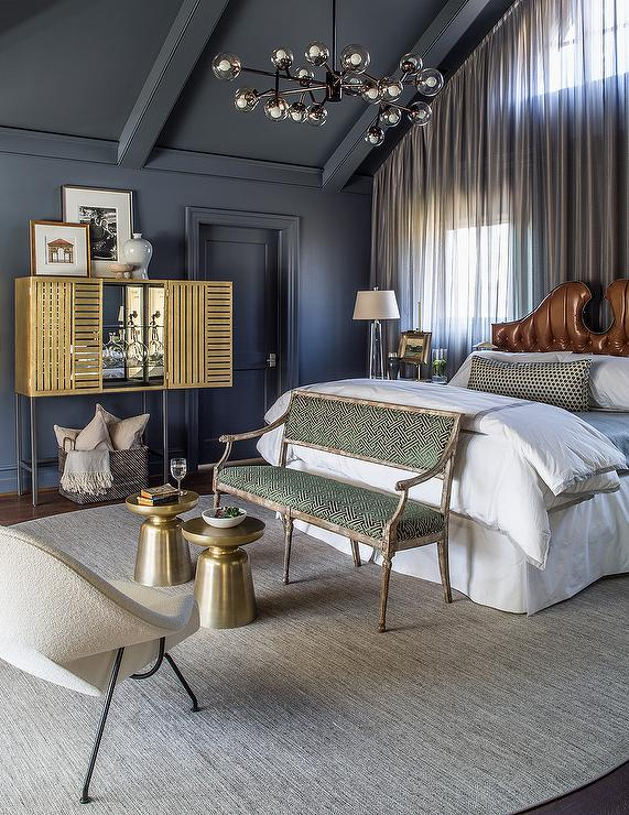 Gray Bedroom With Gold Bar Cabinet