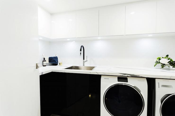 Laundry Room with White Upper Cabinets and Black Lower Cabinets ...