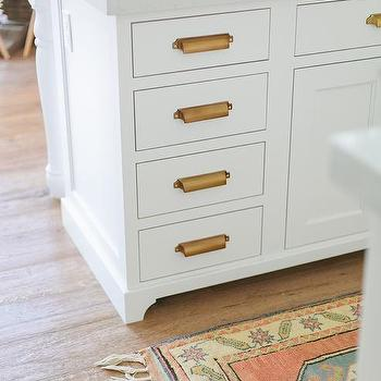 White Kitchen Island With Brass Library Pulls