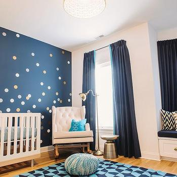 gold and blue boy 39 s nursery features an accent wall painted benjamin