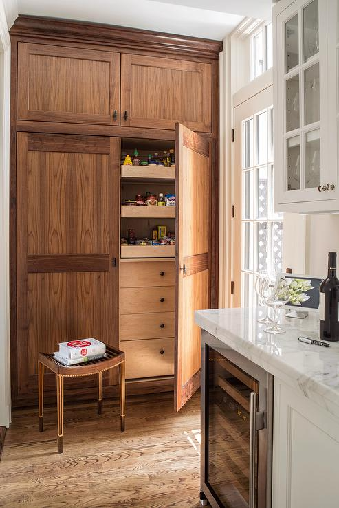 Fantastic Kitchen Features A Wall Of Stained Oak Pantry Cabinets Fitted  With Pull Out Shelves.
