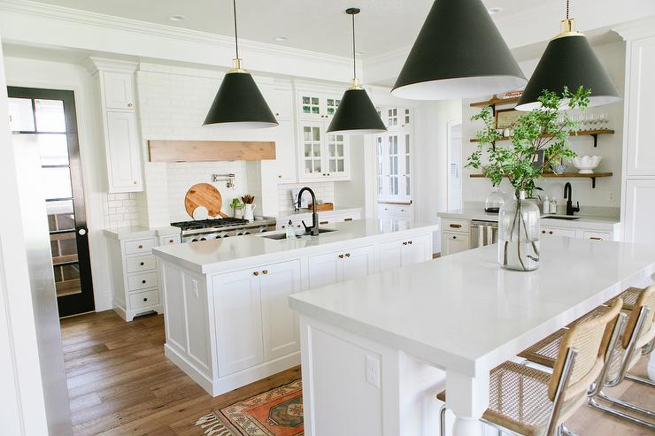 White Kitchen Island With Black Cone Pendants