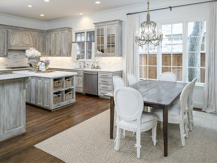 French Kitchen Features Gray Distressed Cabinets Paired With Danby