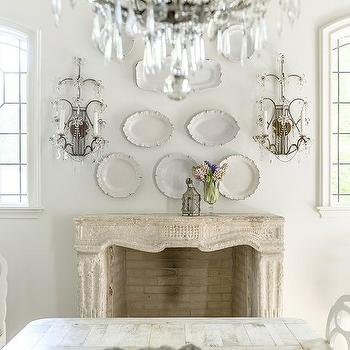 Dining Room With Decorative Plates Over Fireplace