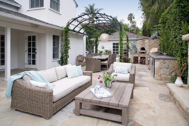 Arched Pergola With Outdoor Kitchen And Corner Pizza Oven