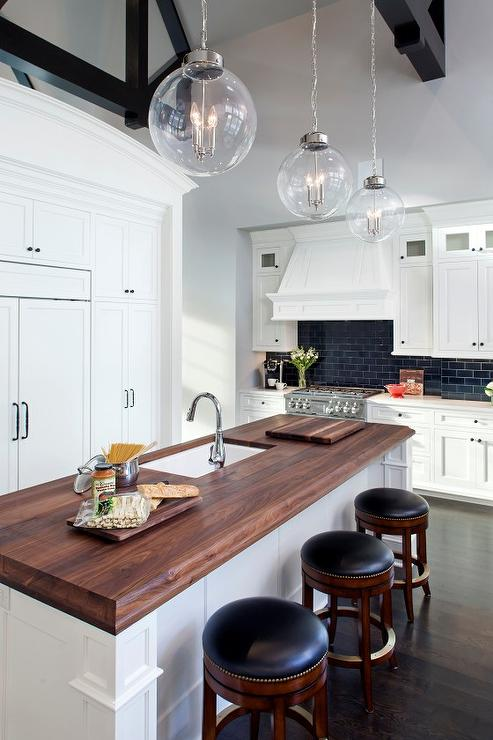 Butcher Block Top Island With Backless Round Black Leather Stools