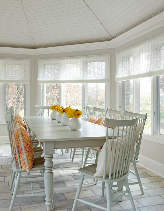 gray farmhouse dining table with gray windsor dining chairs