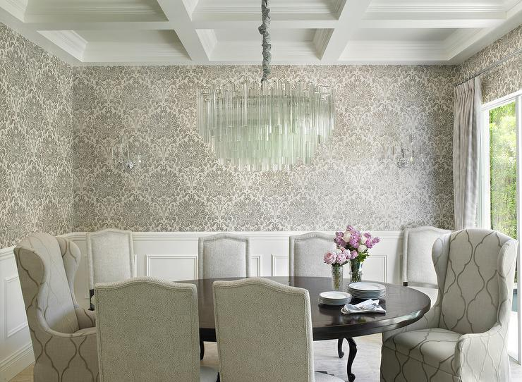 White And Gray Dining Room Features Top Half Of Walls Clad In Gray And  Black Damask Wallpaper And Bottom Half Of Walls Clad In Wainscoting.