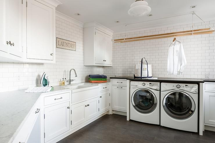 Large Cottage Laundry Room With Two Gray Barn Doors On