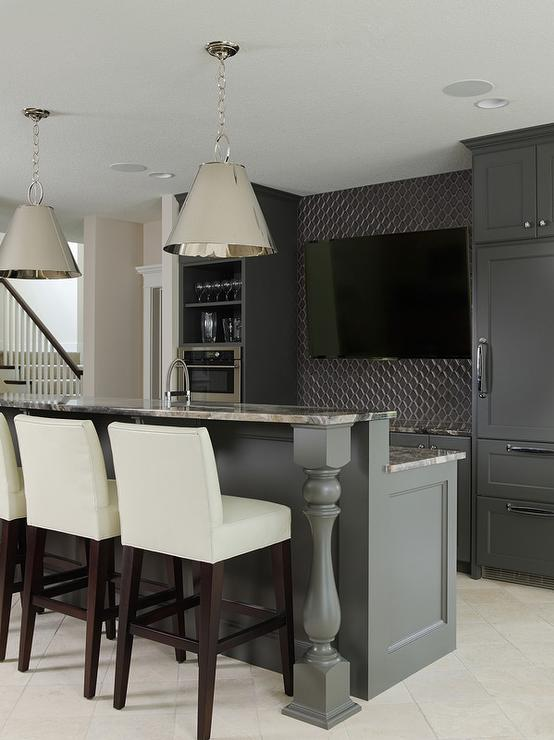 Sleek Basement Bar Features Black Cabinets Paired With Gray Granite  Countertops And A Gray Geometric Tile Backsplash.