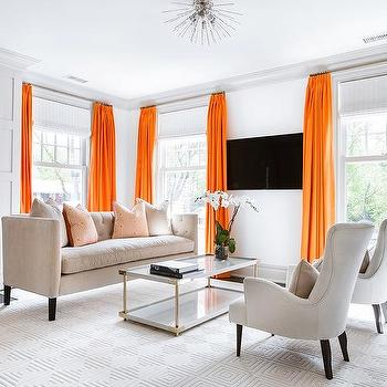 white sofa with black pillows and orange curtains - contemporary
