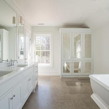 White Bathroom With Antiqued Mirrored Linen Cabinet