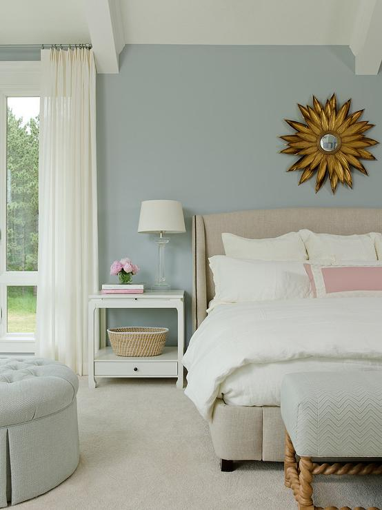 Gold sunburst mirror over wingback bed transitional for Pink and blue bedroom