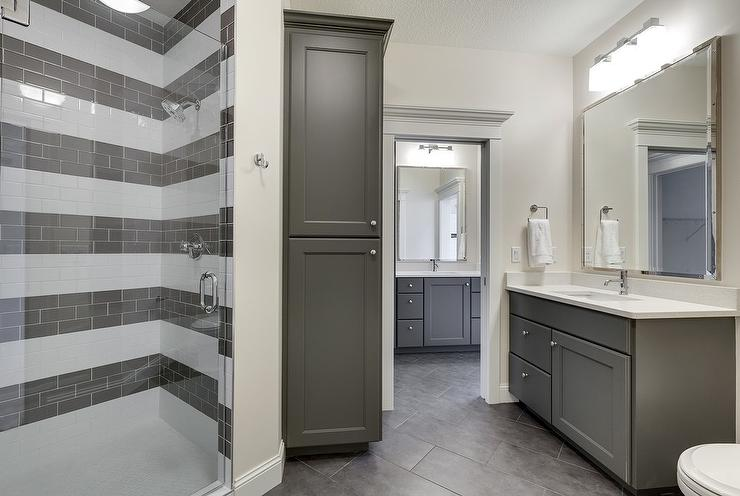 Charcoal Gray Bathroom With White And Gray Striped Shower Tiles