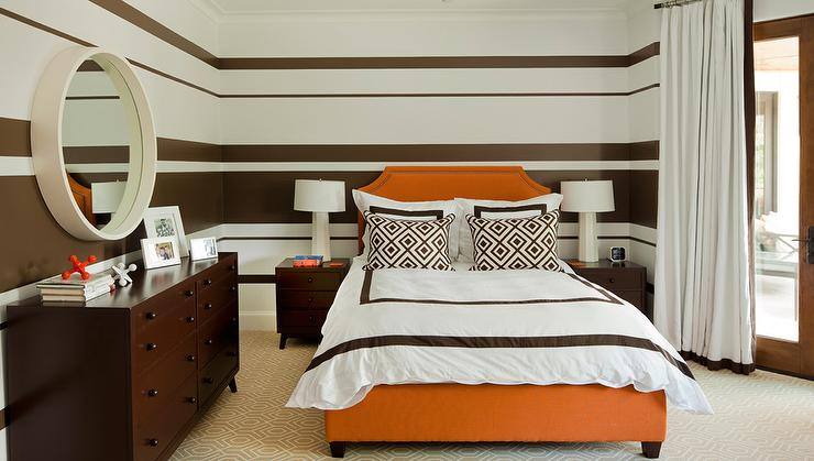 orange and brown bedroom features brown striped walls lined with a hermes orange bed dressed in white and brown border bedding as well as brown diamond - Orange Bedroom 2016