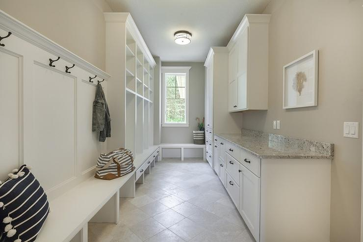 White Mudroom With Gray Granite Countertops Transitional