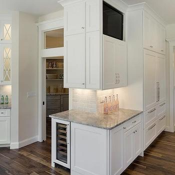 Angled Kitchen with Super White Granite Countertops