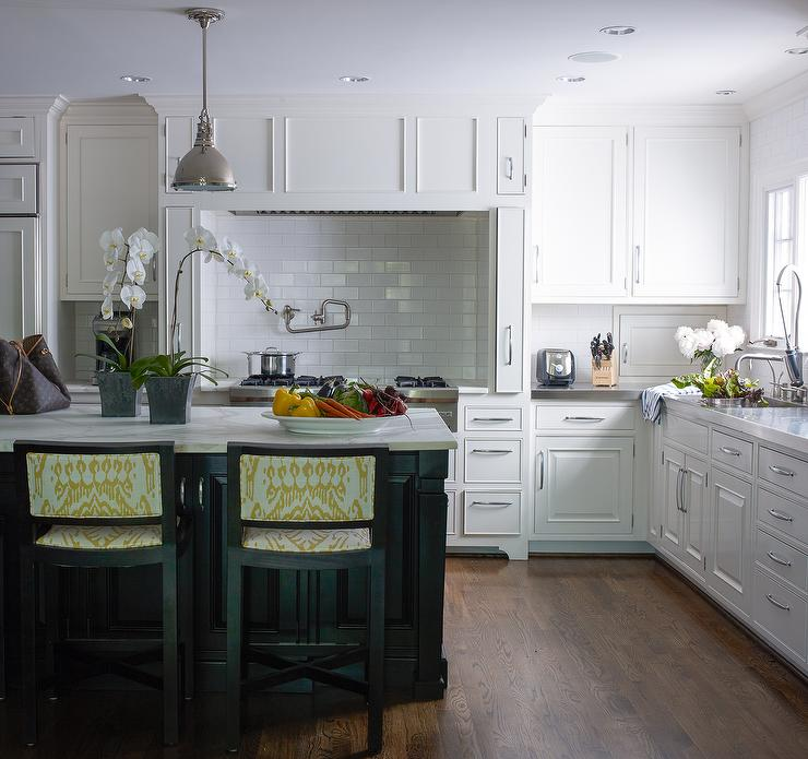 Attractive White Kitchen With Black Island And Yellow Ikat Counter Stools