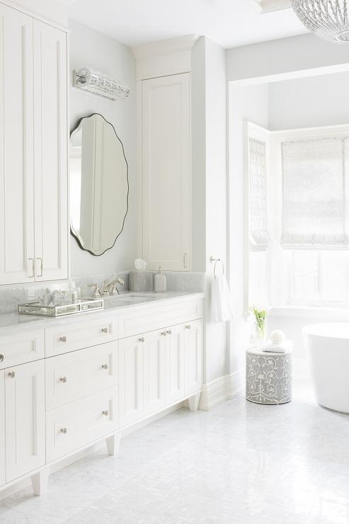 Gray And White Master Bathroom With Side Medicine Cabinets