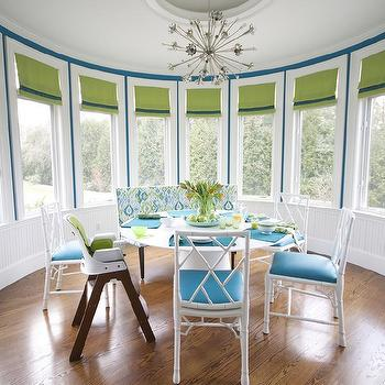 Round Dining Room With White Bamboo Chairs