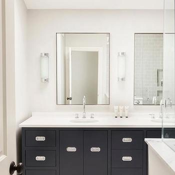 white and black master bathroom with skylights