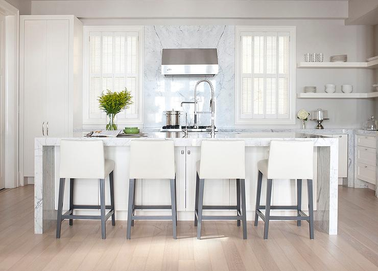 off white kitchen cabinets. Off white kitchen features off cabinets paired with gray marble  countertops and a slab backsplash that goes all the way up to cieling White Kitchen Cabinets Design Ideas