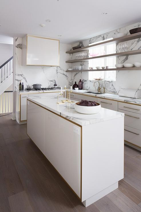 White And Gold Kitchen Cabinets With Gray Floating Shelves