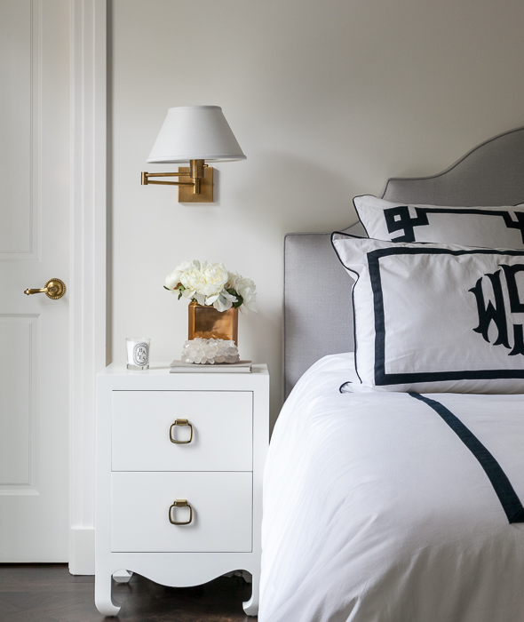 Gray Bedroom With Monogrammed Shams And Antique Brass Sconces
