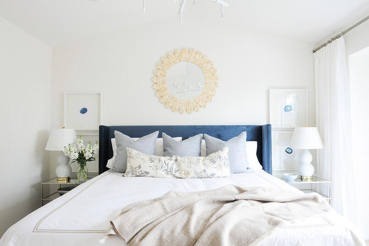 Blue Wingback Bed With Bone Sunburst Mirror