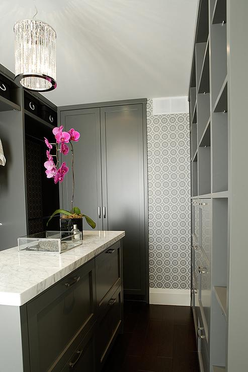 White And Gray Walk In Closet With Mirrored Closet Doors