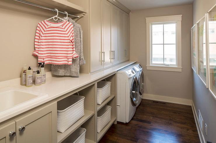 Long Laundry Room With Taupe Cabinets And Shelves