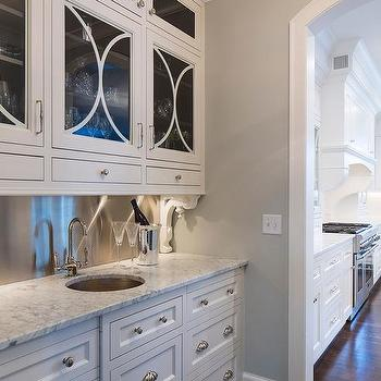 wet bar with mercury glass pendant and marble chevron
