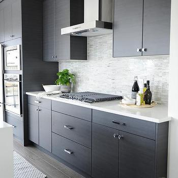 Modern gray kitchen with round chrome counter stools for Dark gray kitchen cabinets