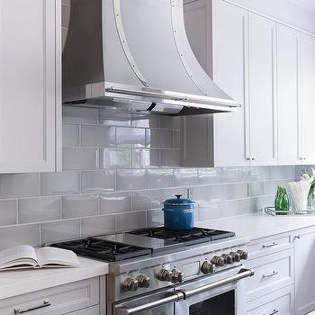 white quartz countertops and a gray beveled subway tile backsplash