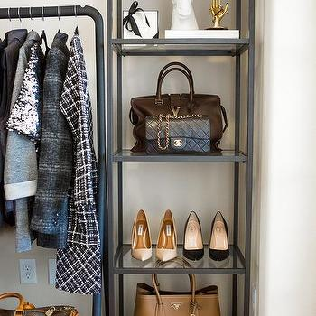 Closet With Ikea Shelving Unit Lined With Shoes And Designer Bags