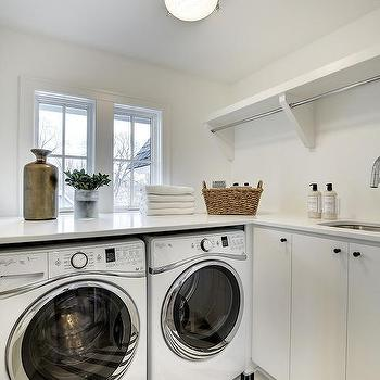 Washer And Dryer Tucked Under Countertop With Black And White Floor Tiles