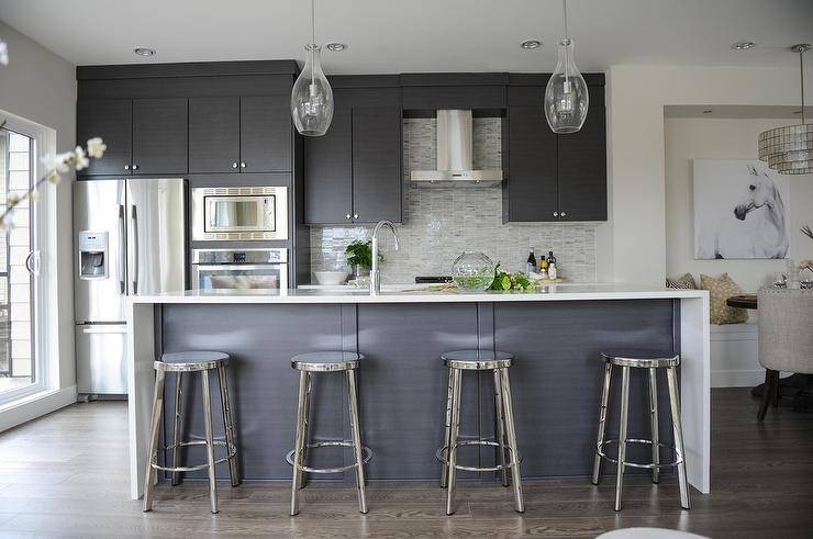 Modern gray kitchen with round chrome counter stools for Modern white and gray kitchen