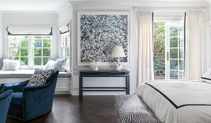 White And Navy Bedroom With Chinoiserie Table Next To French Doors Juilet Balcony