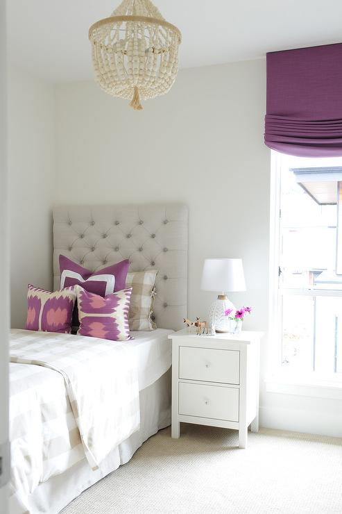 Tan And Purple Girls Bedroom With One Nightstand